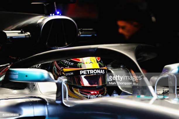Lewis Hamilton of Great Britain and Mercedes GP prepares to drive in the garage during practice for the Formula One Grand Prix of Belgium at Circuit...