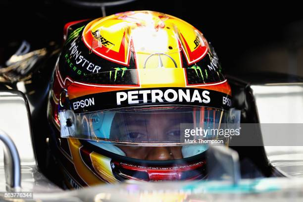 Lewis Hamilton of Great Britain and Mercedes GP prepares to drive in the garage during practice for the United States Formula One Grand Prix at...