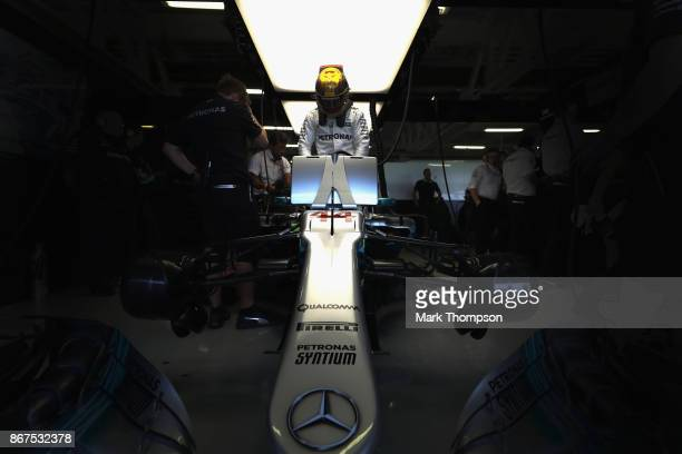 Lewis Hamilton of Great Britain and Mercedes GP prepares to drive in the garage during qualifying for the Formula One Grand Prix of Mexico at...