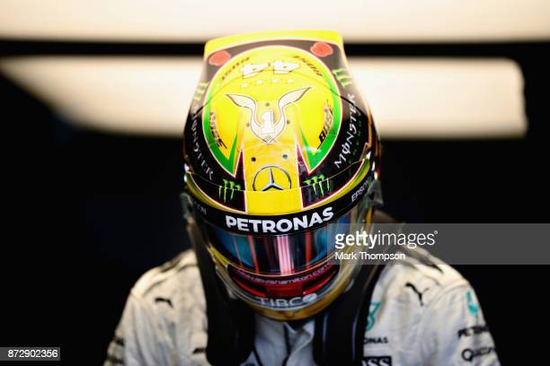 Lewis Hamilton of Great Britain and Mercedes GP prepares to drive in the garage during qualifying for the Formula One Grand Prix of Brazil at...