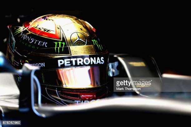 Lewis Hamilton of Great Britain and Mercedes GP prepares to drive in the garage during practice for the Abu Dhabi Formula One Grand Prix at Yas...