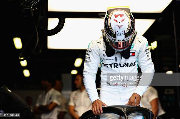 Lewis Hamilton of Great Britain and Mercedes GP prepares to drive in the garage during final practice for the Australian Formula One Grand Prix at...