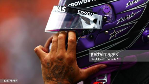 Lewis Hamilton of Great Britain and Mercedes GP prepares to drive on the grid before the F1 Grand Prix of Hungary at Hungaroring on August 01, 2021...