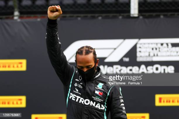 Lewis Hamilton of Great Britain and Mercedes GP raises his fist as he stands on the podium in a stand against racism after the Formula One Grand Prix...