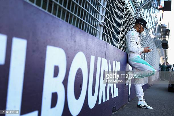 Lewis Hamilton of Great Britain and Mercedes GP relaxes on the grid ahead of the Australian Formula One Grand Prix at Albert Park on March 20 2016 in...
