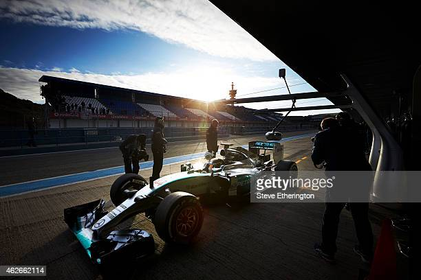 Lewis Hamilton of Great Britain and Mercedes GP returns to the garage during day two of Formula One Winter Testing at Circuito de Jerez on February...