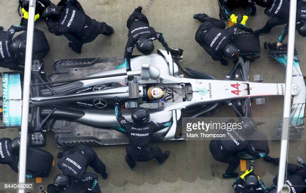 Lewis Hamilton of Great Britain and Mercedes GP returns to the garage for a tyrechange during the launch of the Mercedes formula one team's 2017 car...