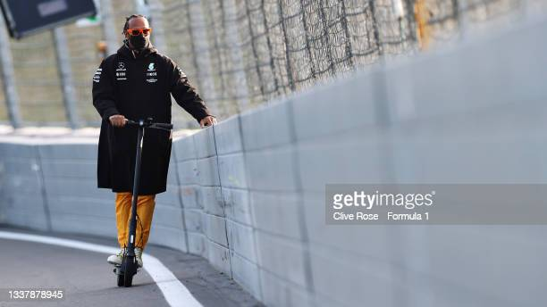 Lewis Hamilton of Great Britain and Mercedes GP rides a lap of the track on his scooter during previews ahead of the F1 Grand Prix of The Netherlands...
