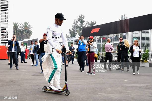 Lewis Hamilton of Great Britain and Mercedes GP rides a scooter to his garage before qualifying for the Formula One Grand Prix of Mexico at Autodromo...