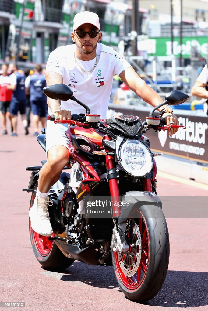 Lewis Hamilton of Great Britain and Mercedes GP rides his motorbike in the Pitlane during previews ahead of the Monaco Formula One Grand Prix at Circuit de Monaco on May 23, 2018 in Monte-Carlo, Monaco.