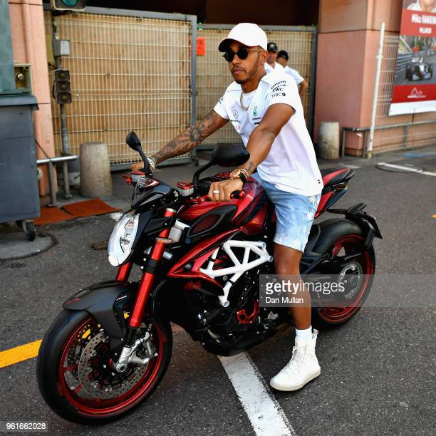 Lewis Hamilton of Great Britain and Mercedes GP rides his motorbike in the Paddock during previews ahead of the Monaco Formula One Grand Prix at...