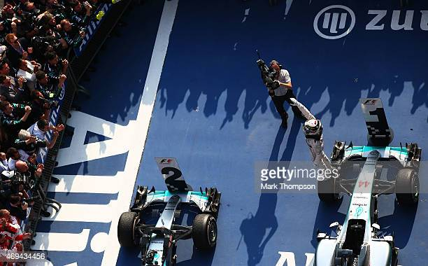 Lewis Hamilton of Great Britain and Mercedes GP salutes the fans following his victory during the Formula One Grand Prix of China at Shanghai...