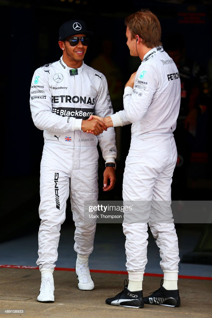 Lewis Hamilton of Great Britain and Mercedes GP shakes hands with team-mate Nico Rosberg of Germany and Mercedes GP after qualifying in pole position ahead of the Spanish F1 Grand Prix at Circuit de Catalunya on May 10, 2014 in Montmelo, Spain.