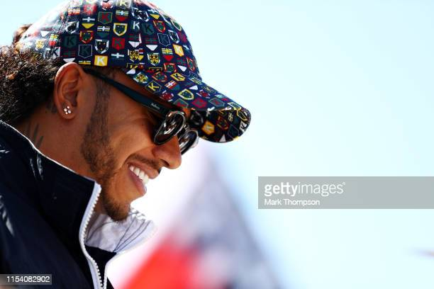 Lewis Hamilton of Great Britain and Mercedes GP signs autographs for fans during previews ahead of the F1 Grand Prix of Canada at Circuit Gilles...