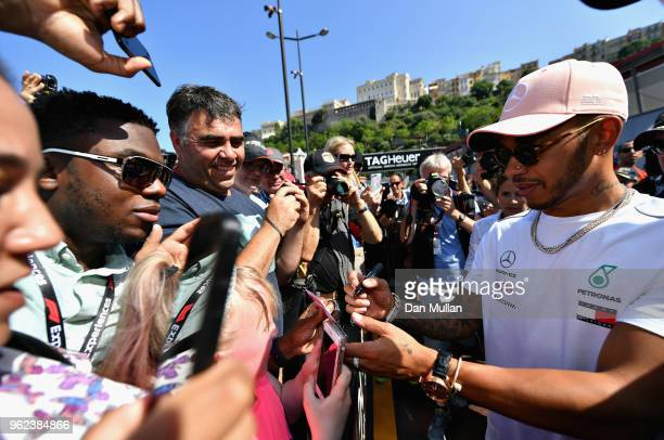 Lewis Hamilton of Great Britain and Mercedes GP signs autographs for fans during previews ahead of the Monaco Formula One Grand Prix at Circuit de...
