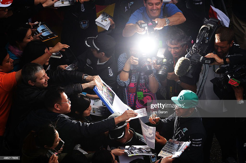 Lewis Hamilton of Great Britain and Mercedes GP signs autographs ahead of the Chinese Formula One Grand Prix at the Shanghai International Circuit on April 17, 2014 in Shanghai, China.