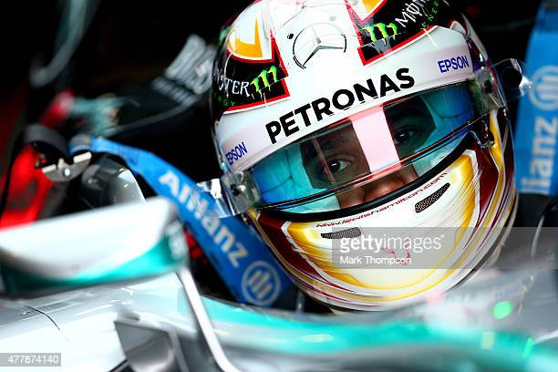 Lewis Hamilton of Great Britain and Mercedes GP sits in his car in the garage during qualifying for the Formula One Grand Prix of Austria at Red Bull...