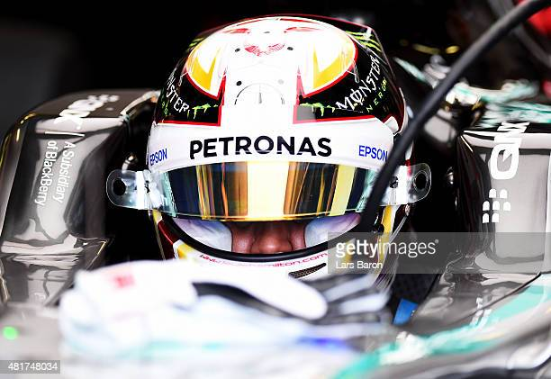 Lewis Hamilton of Great Britain and Mercedes GP sits in his car in the garage during practice for the Formula One Grand Prix of Hungary at...