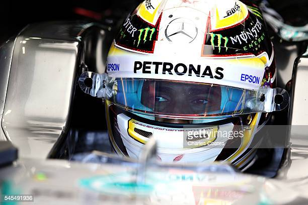 Lewis Hamilton of Great Britain and Mercedes GP sits in his car in the garage during practice for the Formula One Grand Prix of Great Britain at...