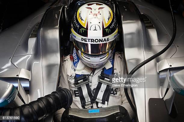 Lewis Hamilton of Great Britain and Mercedes GP sits in his car in the garage during practice for the Formula One Grand Prix of Japan at Suzuka...