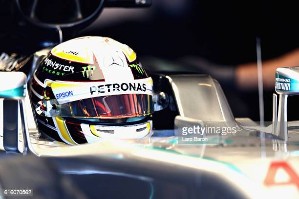 Lewis Hamilton of Great Britain and Mercedes GP sits in his car in the garage during practice for the United States Formula One Grand Prix at Circuit...