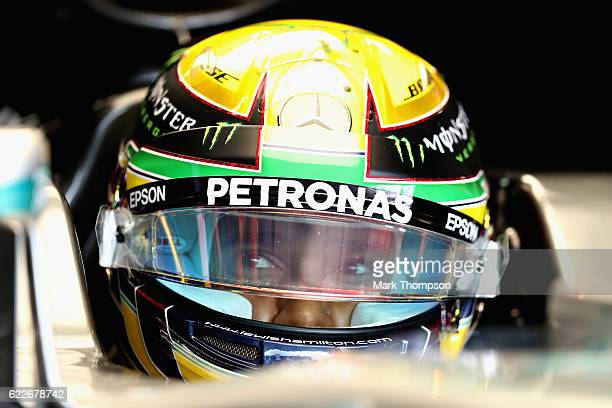 Lewis Hamilton of Great Britain and Mercedes GP sits in his car in the garage during final practice for the Formula One Grand Prix of Brazil at...