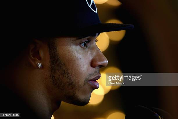 Lewis Hamilton of Great Britain and Mercedes GP speaks to the media during qualifying for the Bahrain Formula One Grand Prix at Bahrain International...