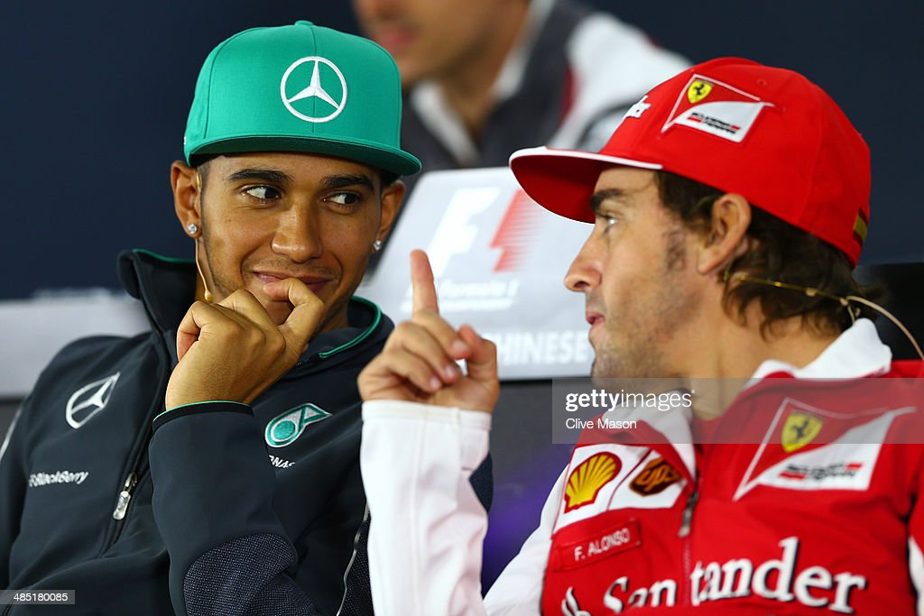 Lewis Hamilton of Great Britain and Mercedes GP speaks with Fernando Alonso of Spain and Ferrari during a press conference ahead of the Chinese Formula One Grand Prix at the Shanghai International Circuit on April 17, 2014 in Shanghai, China.