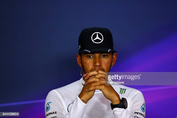 Lewis Hamilton of Great Britain and Mercedes GP speaks with members of the media after winning the Formula One Grand Prix of Austria at Red Bull Ring...