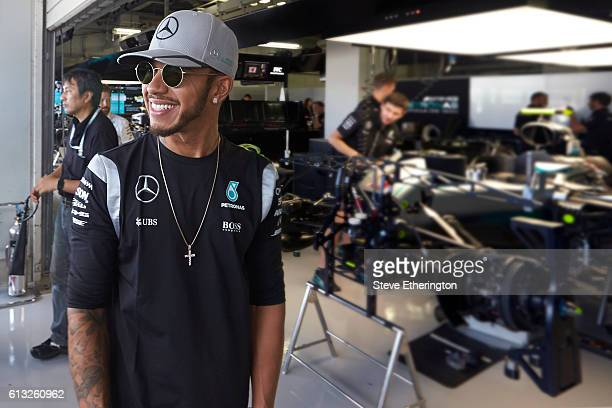 Lewis Hamilton of Great Britain and Mercedes GP stands at the edge of his garage during previews ahead of the Formula One Grand Prix of Japan at...