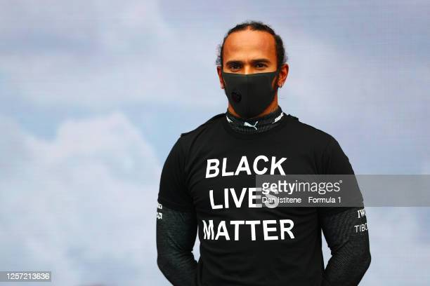 Lewis Hamilton of Great Britain and Mercedes GP stands for the national anthem wearing a t-shirt displaying the message 'black lives matter' before...