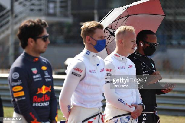Lewis Hamilton of Great Britain and Mercedes GP stands for the national anthem on the grid during the F1 Grand Prix of Italy at Autodromo di Monza on...
