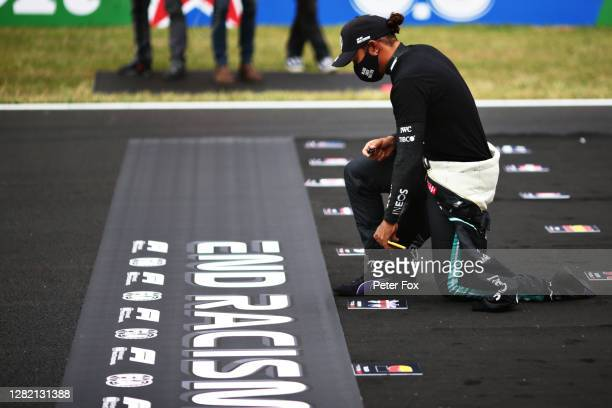Lewis Hamilton of Great Britain and Mercedes GP takes a knee on the grid in support of ending racism during the F1 Grand Prix of Portugal at...