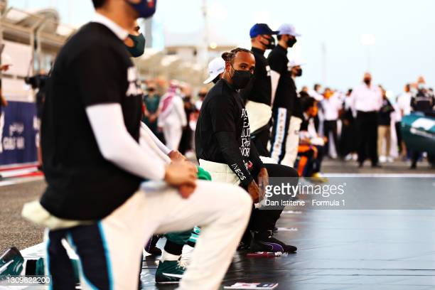 Lewis Hamilton of Great Britain and Mercedes GP takes a knee on the grid in support of ending racism during the F1 Grand Prix of Bahrain at Bahrain...