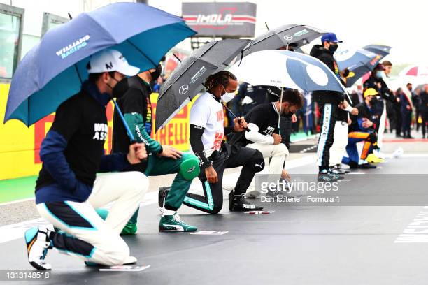 Lewis Hamilton of Great Britain and Mercedes GP takes a knee on the grid in support of the Black Lives Matter movement prior to the F1 Grand Prix of...