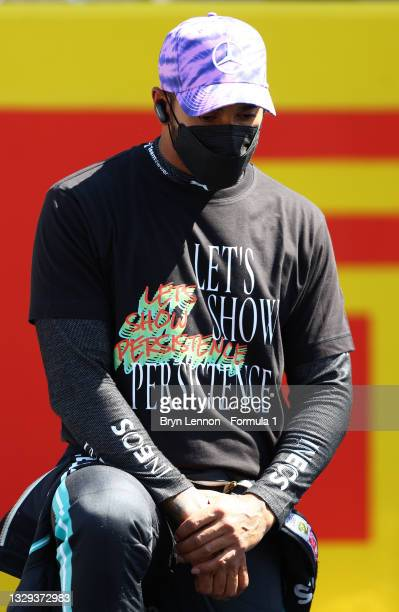 Lewis Hamilton of Great Britain and Mercedes GP takes a knee on the grid before the F1 Grand Prix of Great Britain at Silverstone on July 18, 2021 in...