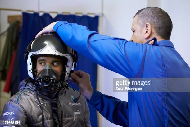 Lewis Hamilton of Great Britain and Mercedes GP takes part in a training and flying session with Red Arrows, on June 21, 2013 at RAF Scampton,...