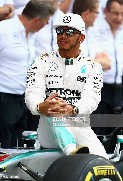 Lewis Hamilton of Great Britain and Mercedes GP takes part in the team photograph in the pit lane before the Abu Dhabi Formula One Grand Prix at Yas...