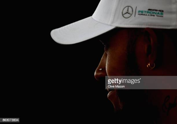 Lewis Hamilton of Great Britain and Mercedes GP talks in the Paddock during previews ahead of the United States Formula One Grand Prix at Circuit of...