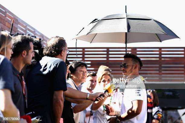 Lewis Hamilton of Great Britain and Mercedes GP talks to the media in the Paddock during previews ahead of the Australian Formula One Grand Prix at...