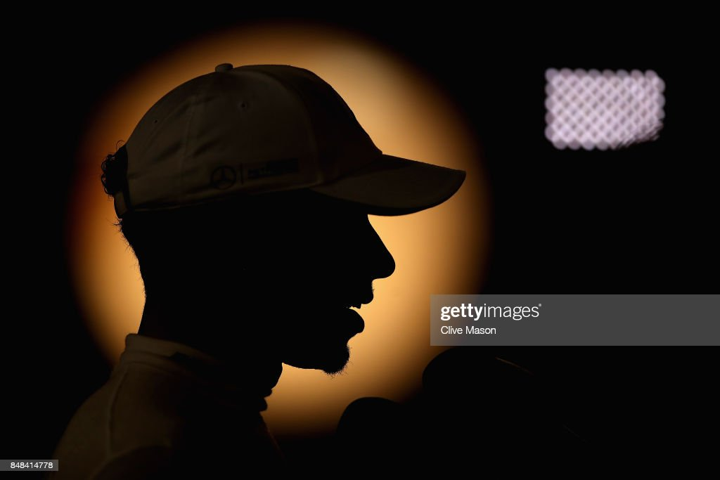 Lewis Hamilton of Great Britain and Mercedes GP talks to the media after the Formula One Grand Prix of Singapore at Marina Bay Street Circuit on September 17, 2017 in Singapore.