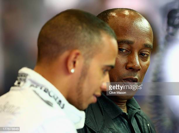 Lewis Hamilton of Great Britain and Mercedes GP talks with his father Anthony Hamilton as he prepares to drive in the final practice session prior to...