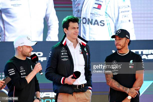 Lewis Hamilton of Great Britain and Mercedes GP Valtteri Bottas of Finland and Mercedes GP and Mercedes GP Executive Director Toto Wolff talk on...