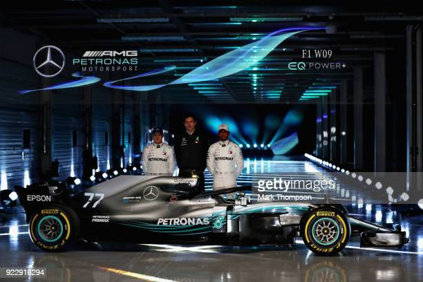 Lewis Hamilton of Great Britain and Mercedes GP Valtteri Bottas of Finland and Mercedes GP and Mercedes GP Executive Director Toto Wolff pose for a...