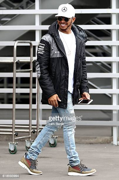 Lewis Hamilton of Great Britain and Mercedes GP walk in the Paddock during previews to the Formula One Grand Prix of Mexico at Autodromo Hermanos...