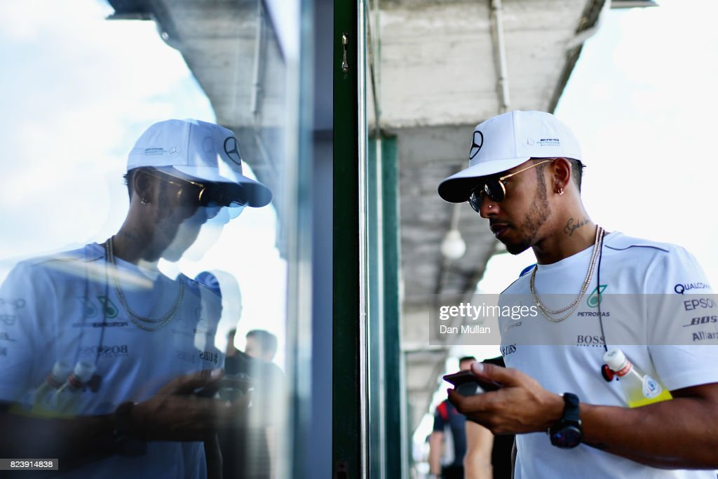 Lewis Hamilton of Great Britain and Mercedes GP walks after practice for the Formula One Grand Prix of Hungary at Hungaroring on July 28, 2017 in Budapest, Hungary.