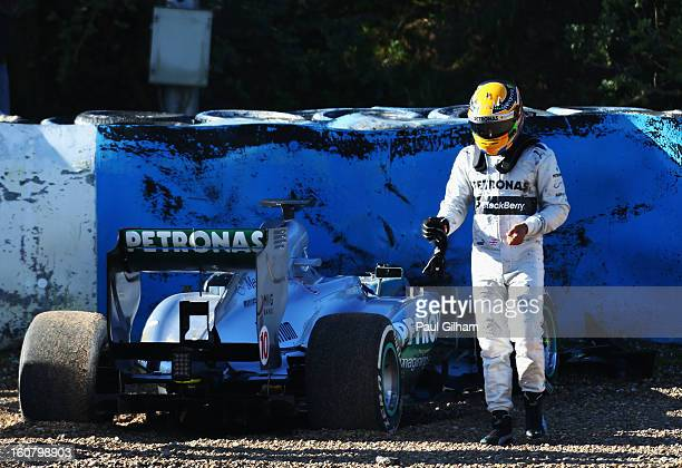 Lewis Hamilton of Great Britain and Mercedes GP walks away from his car after crashing into the gravel at turn six during Formula One winter testing...
