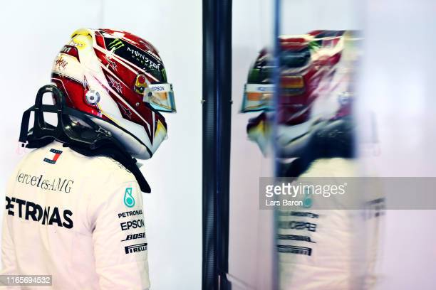 Lewis Hamilton of Great Britain and Mercedes GP walks in the garage during practice for the F1 Grand Prix of Hungary at Hungaroring on August 02,...