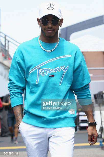 Lewis Hamilton of Great Britain and Mercedes GP walks in the Paddock during previews ahead of the Formula One Grand Prix of Germany at Hockenheimring...