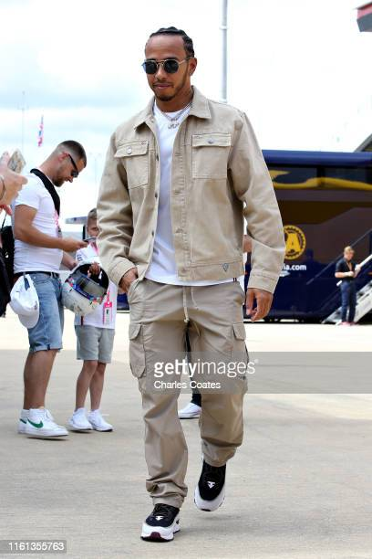 Lewis Hamilton of Great Britain and Mercedes GP walks in the Paddock during previews ahead of the F1 Grand Prix of Great Britain at Silverstone on...